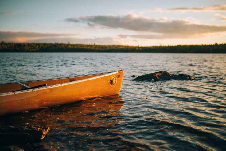 yellow canoe on body of water